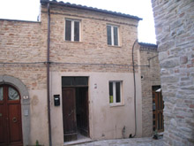 Townhouse in one of the most characteristic and lively villages of Le Marche with beautiful views on the countryside and village.
