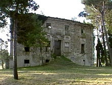 An ancient villa, a large stone cottage with a church and a farmhouse in a large park with woods, surrounded by trees and vegetation, in a dominant position overlooking the hills of Vallesina.