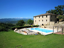 A large stone farmhouse and separate villa near Ascoli Piceno, with open views of the Sibillini and the Gran Sasso.