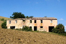 Large old farmhouse needing total restoration on the Osimo hills.