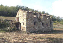 A typical farmhouse in need of restoration with panoramic views in the countryside under the Sibillini Mountains.